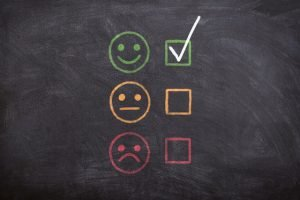 Write A Review For A Moving Company? - blackboard with smiley faces