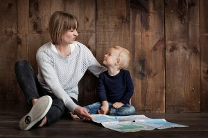 Tips for Relocating Your Family - mum and son on the floor with a map