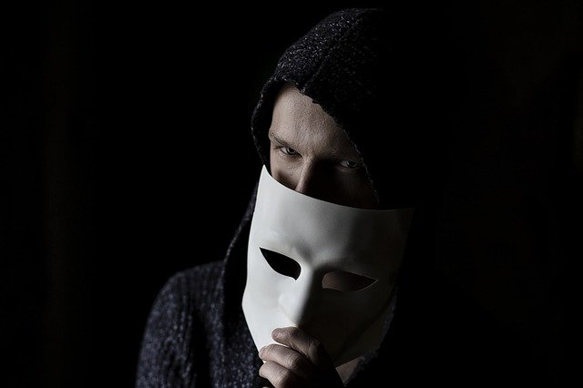 Man hiding behind the mask