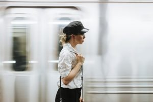 moving to New York - woman in front of the train